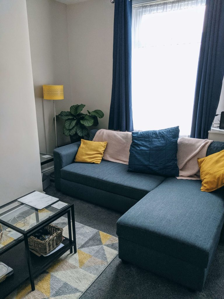5 lessons from buying our first home - Kat Horrocks manchester blogger. Navy and mustard living room interior with Made.com sofa